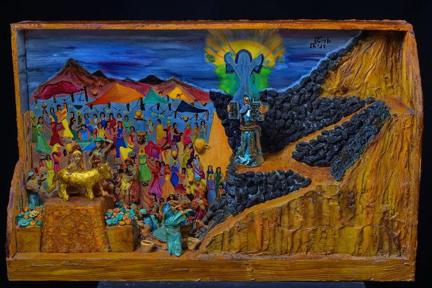 משה יורד מהר סיני עם לוחות הברית